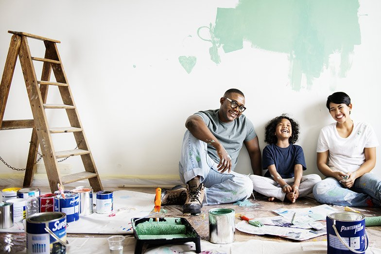 A nice family painting a room together
