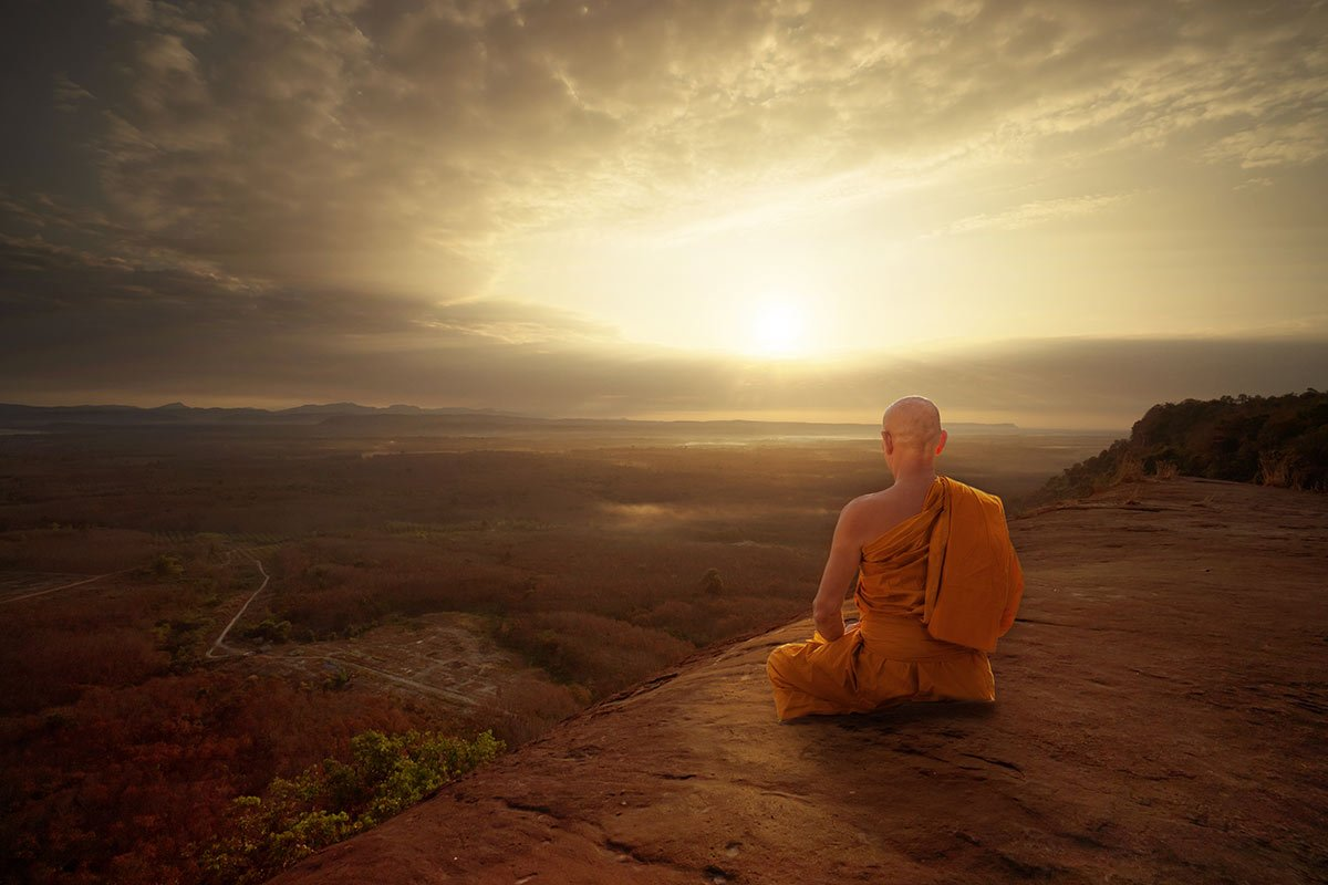 A monk quietly contemplating the sunset