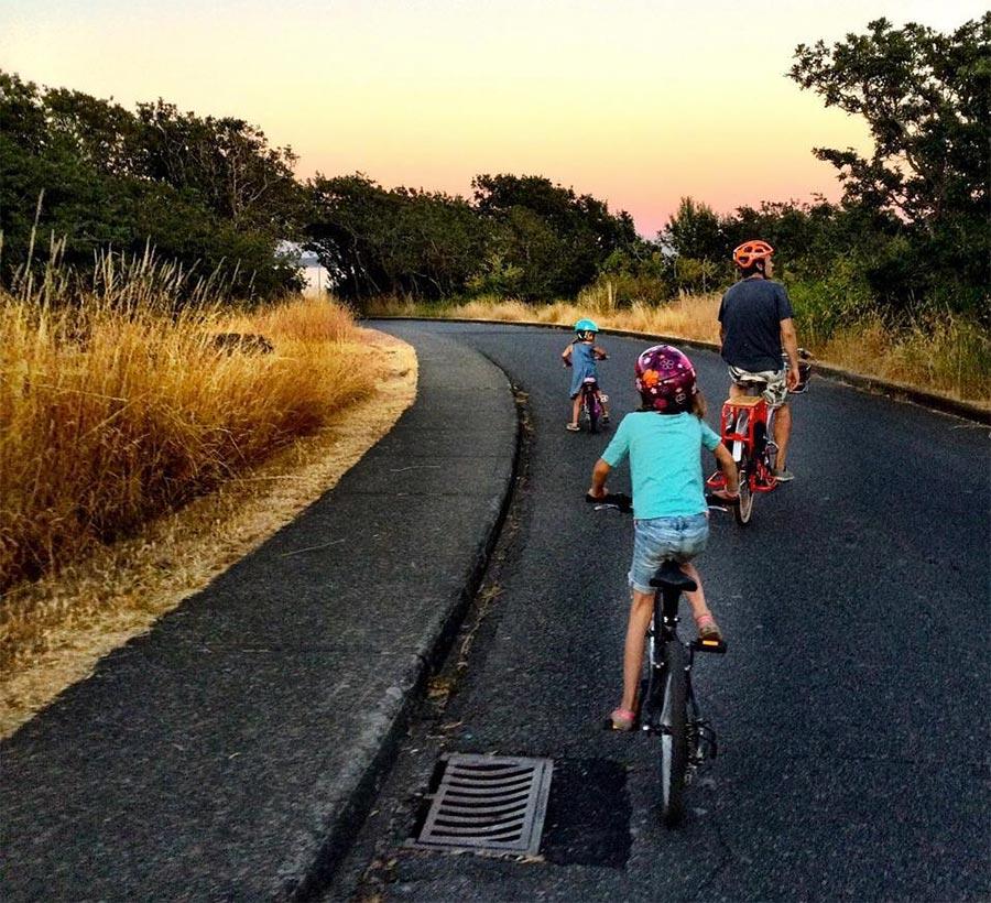Simon Whitfield and kids riding their bikes