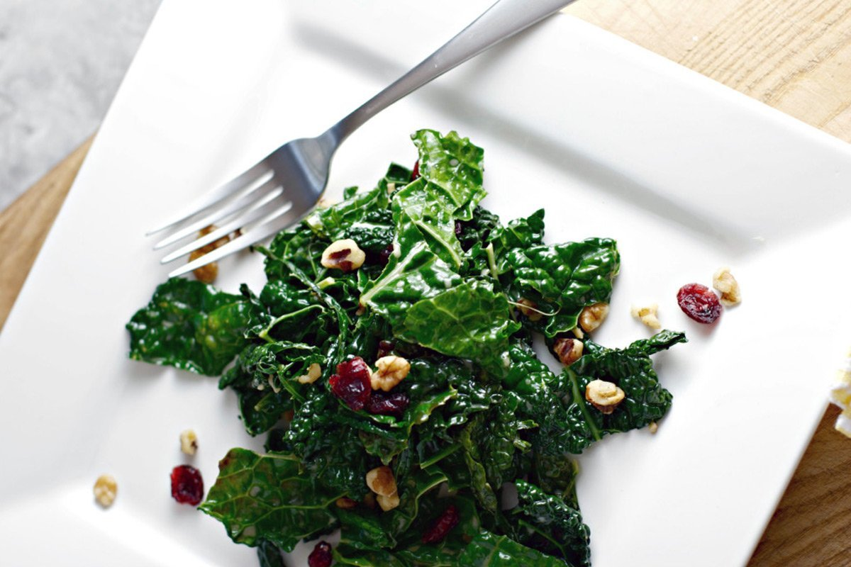 Kale salad served on white plate