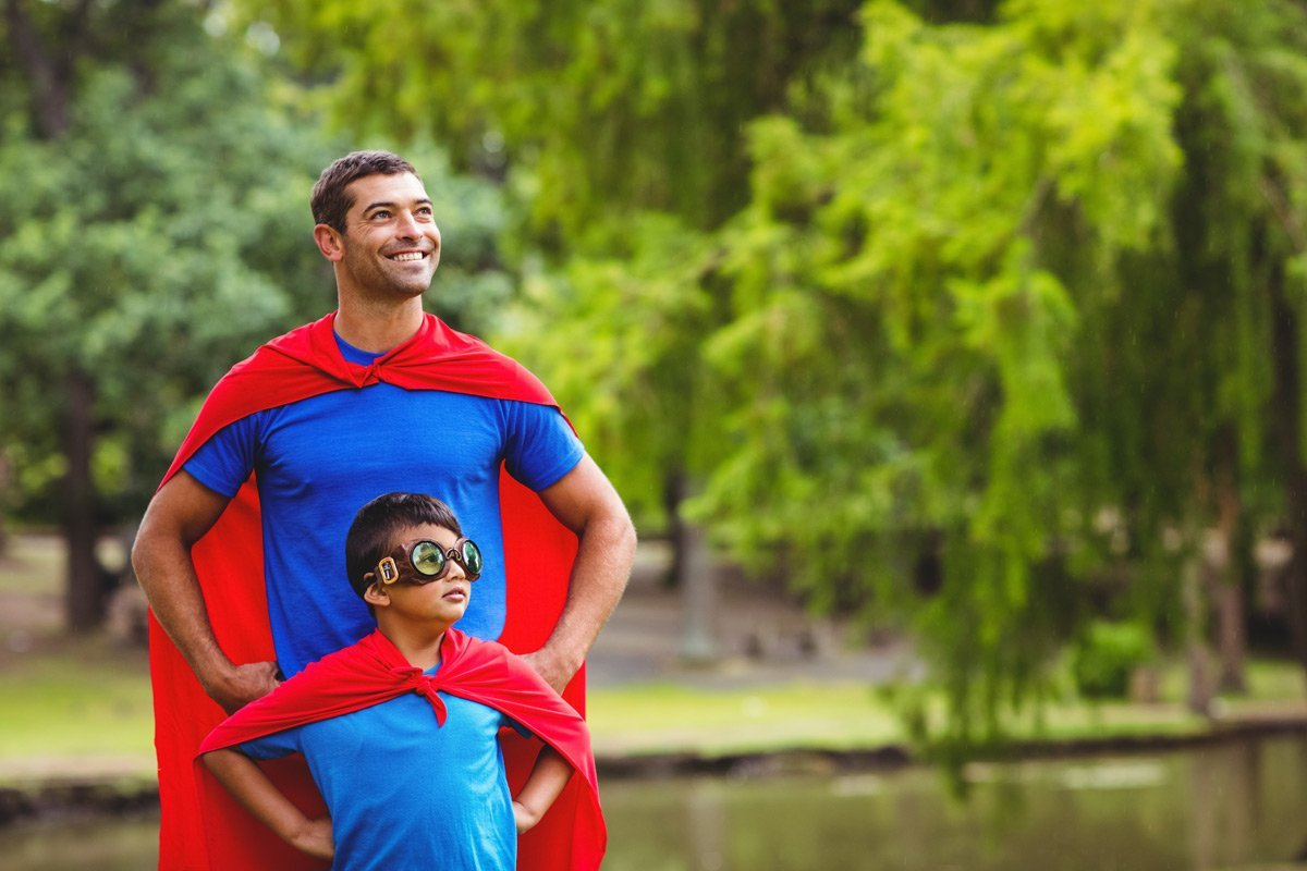 Dad with son wearing red cape