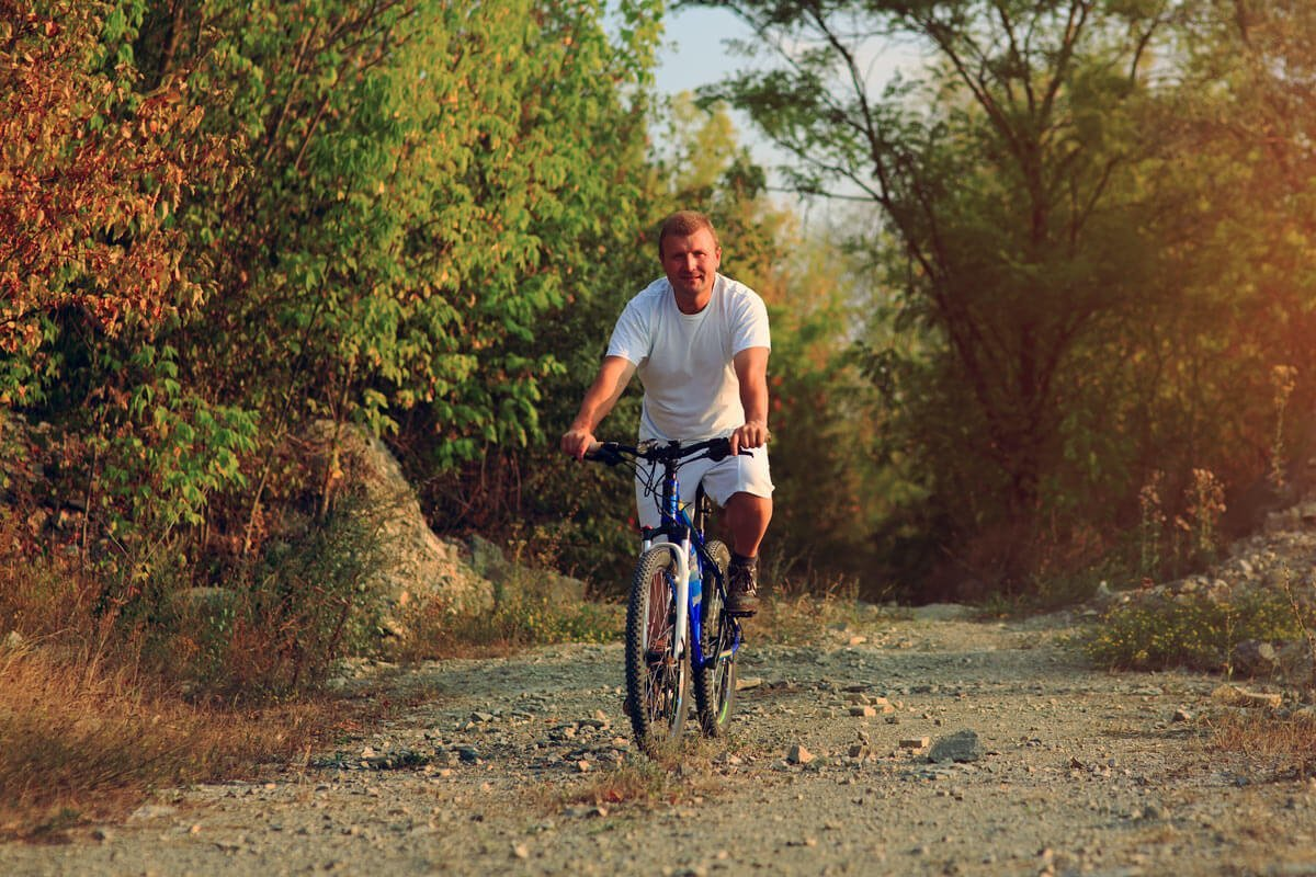 Man riding a bike, spending time in the open air