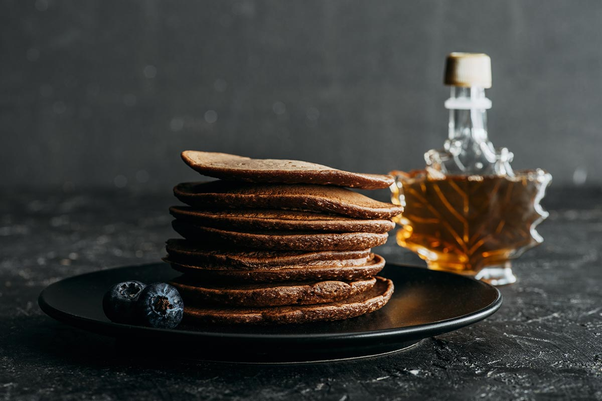 Stack of pancakes with delicious maple syrup