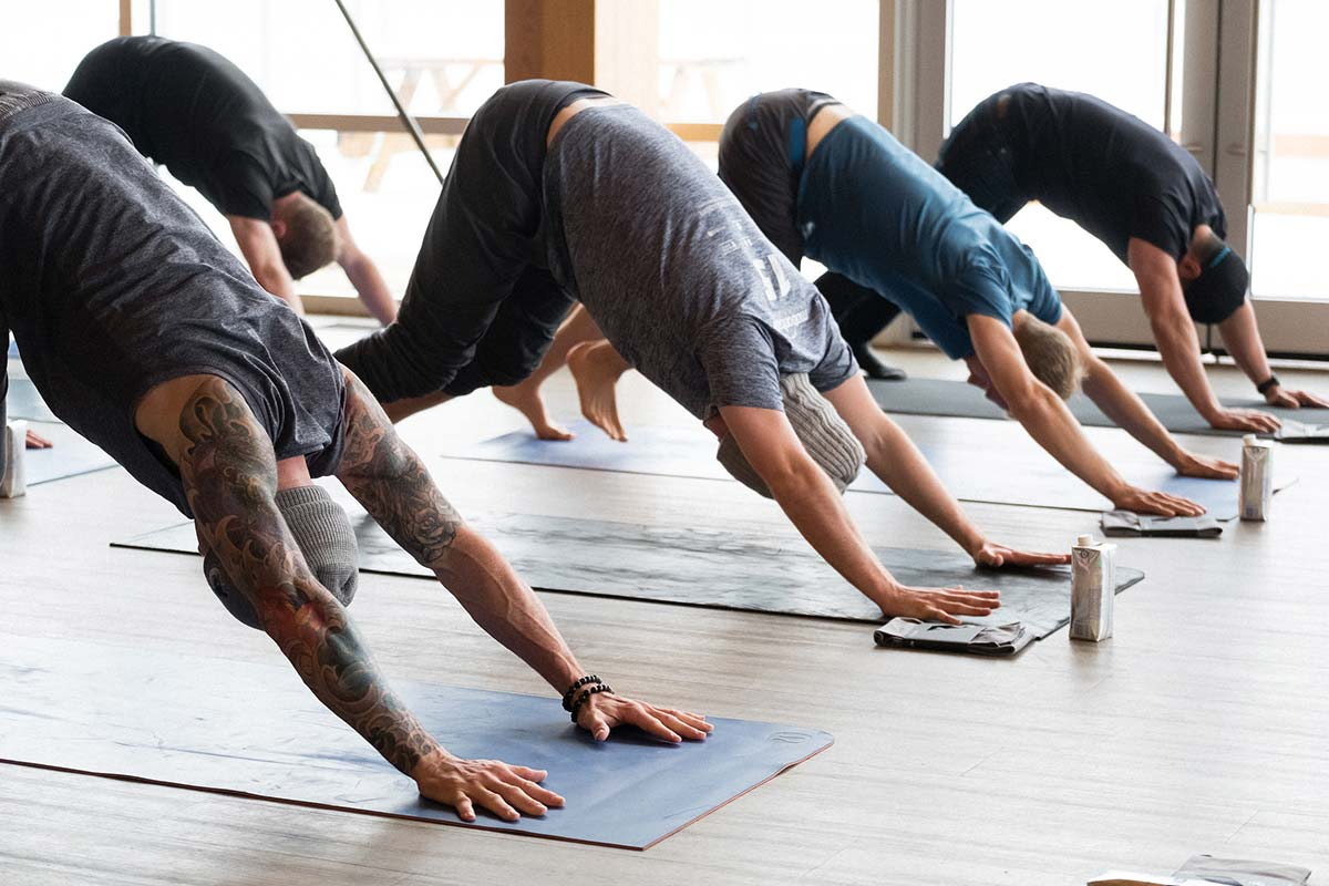 Guys doing yoga at CMHF's Wellmen Event