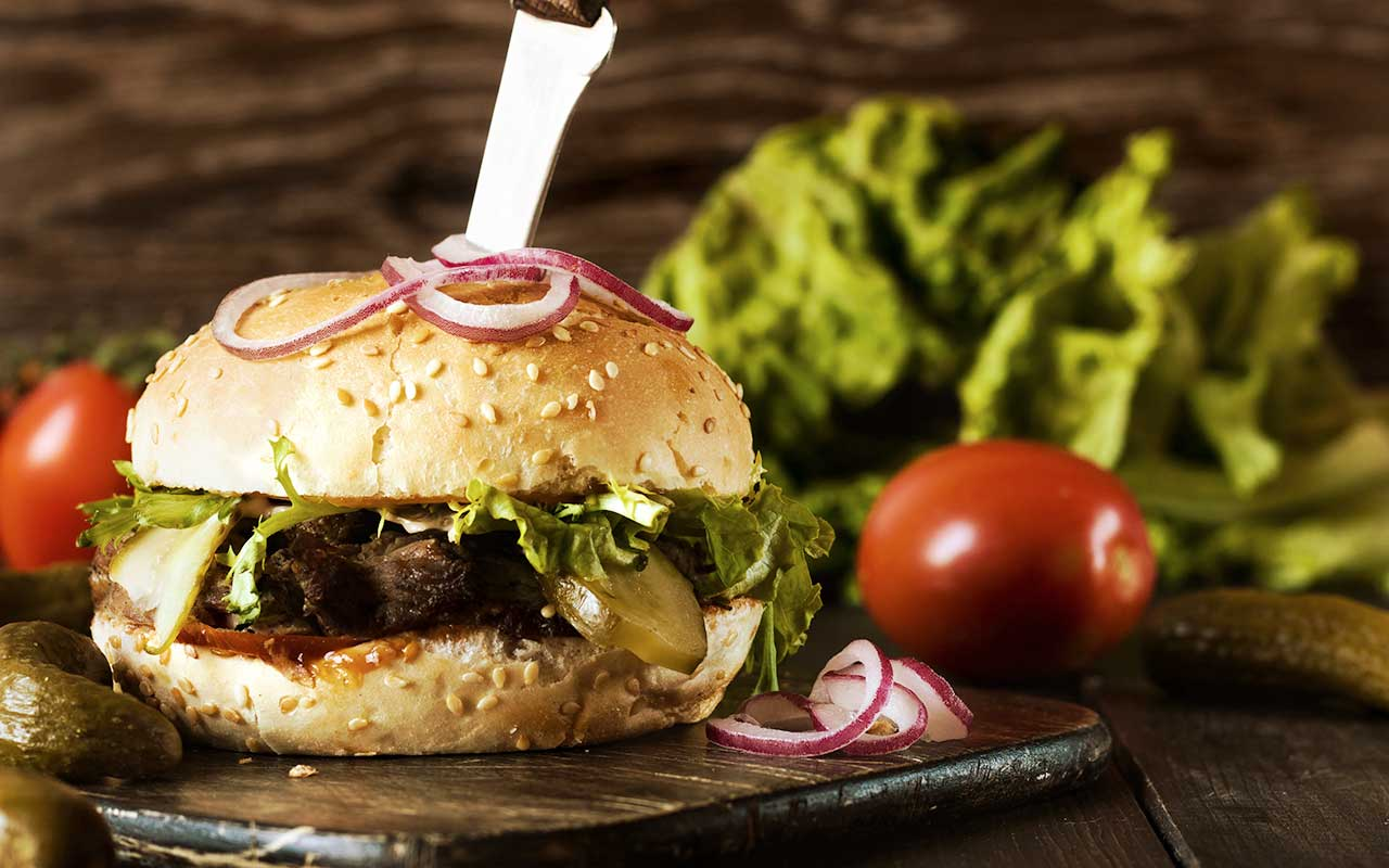 Delicious burger with side salad
