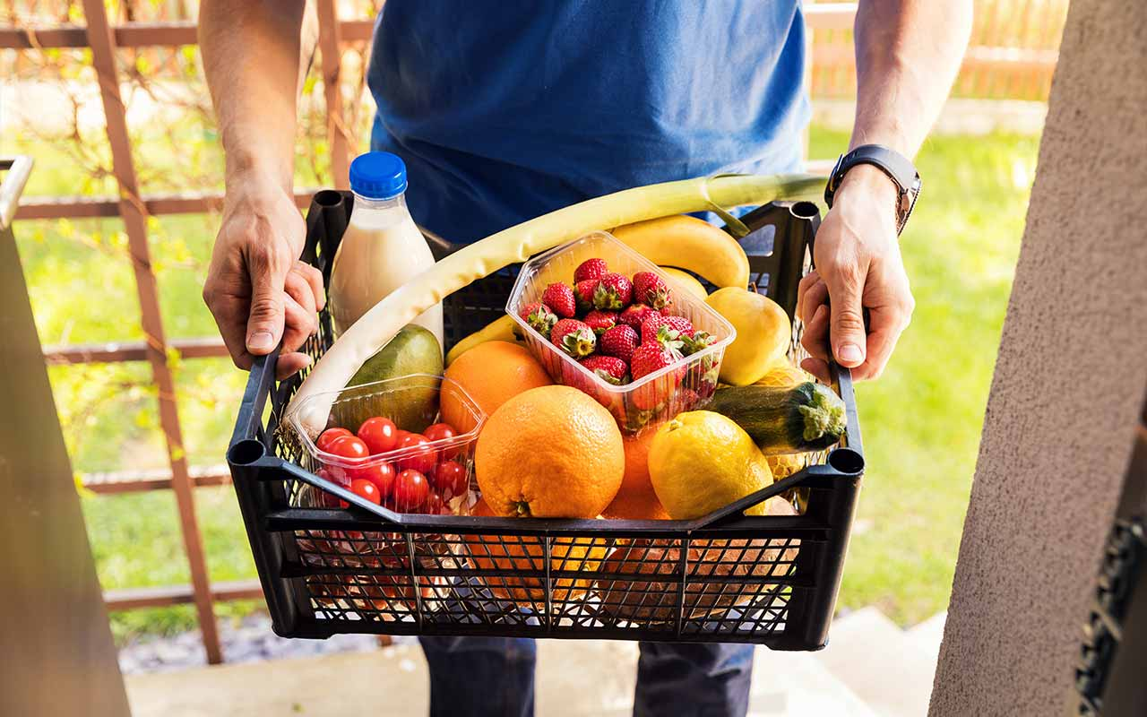 Man holding his healthy groceries