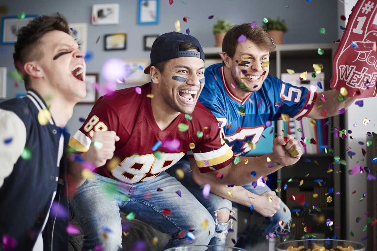 fans watching sports game and cheering
