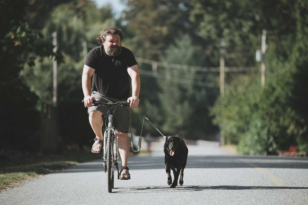 Toby Hargrave biking with dog