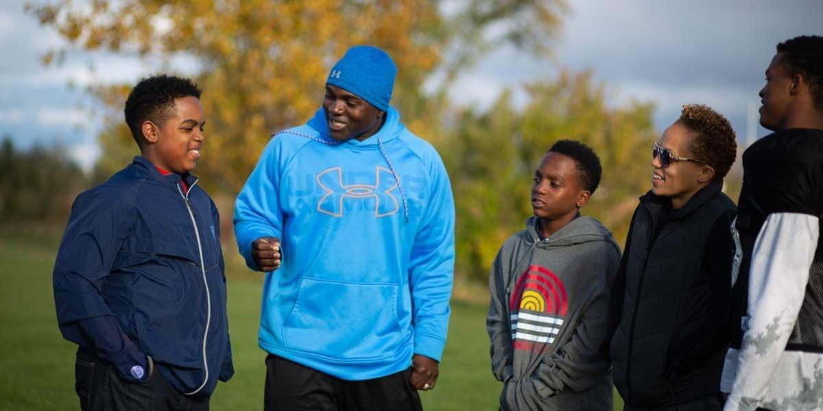 orlando bowen coaching children on field