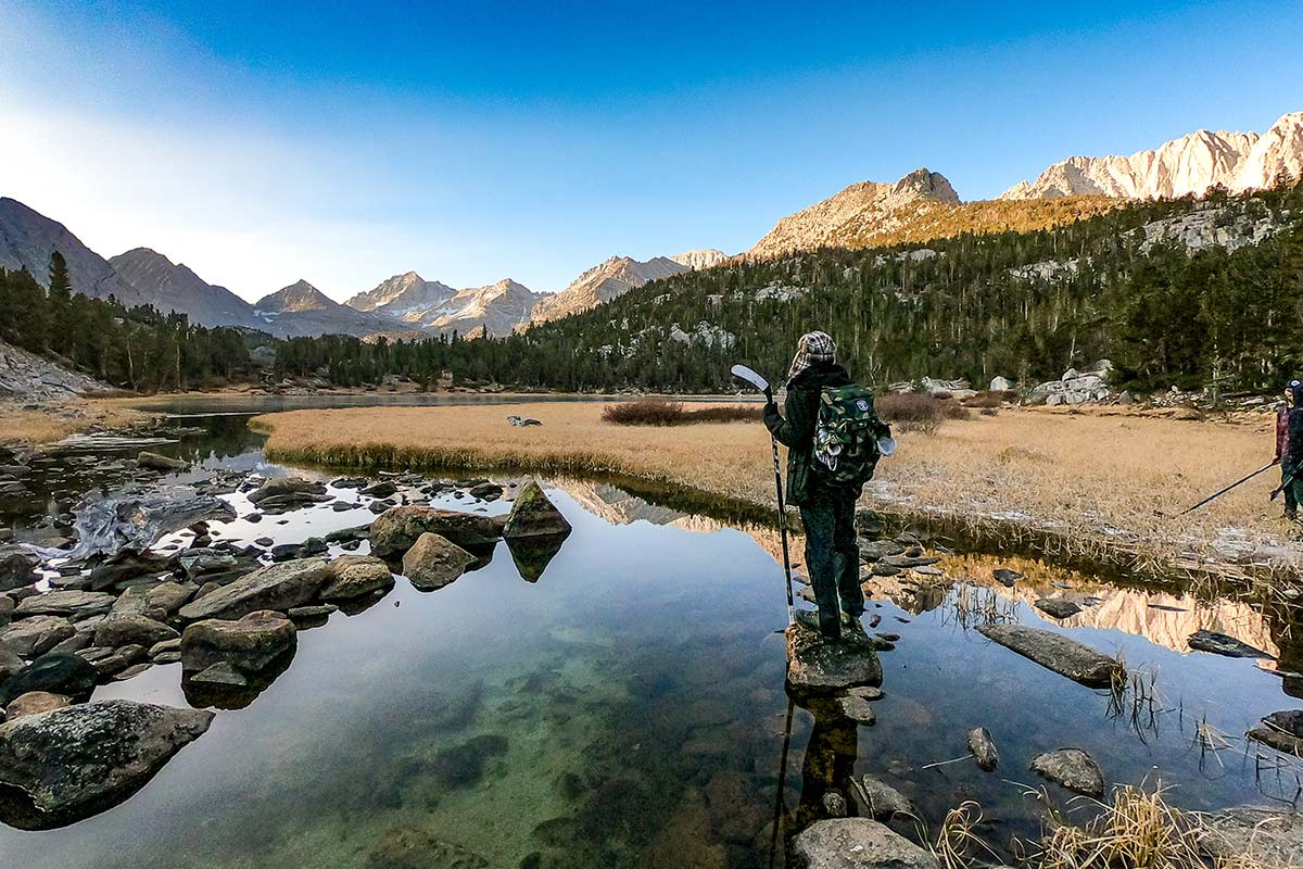man in walking in beautiful landscape with mountains and river
