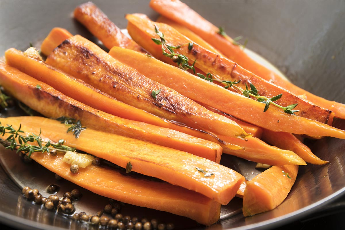 sliced carrots with rosemary