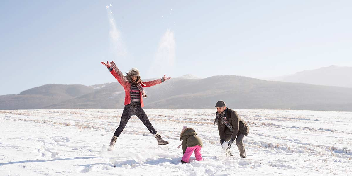 A family walking in a national park in the snow