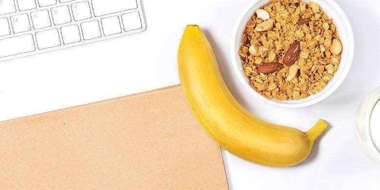 nuts and a banana at the desk