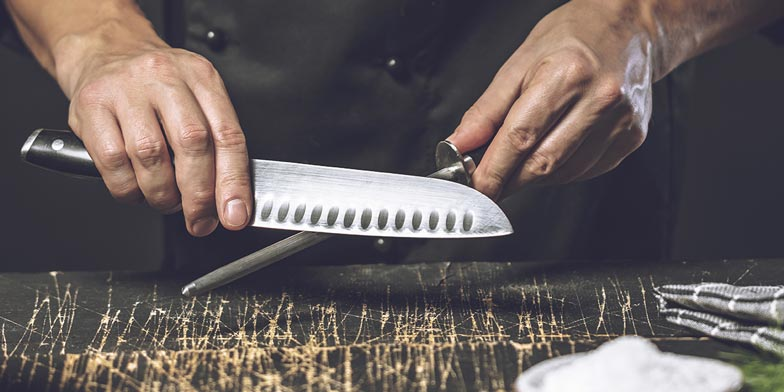 a man sharpening his cooking knife