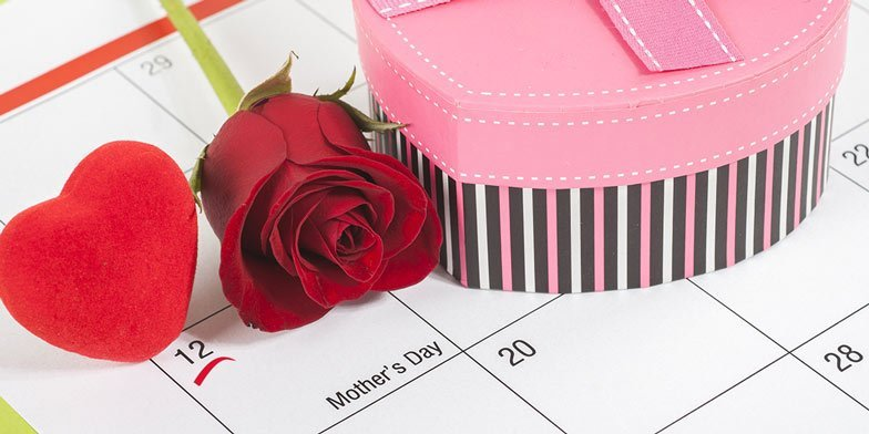 May. 11th marked on a calendar with a rose and heart-shaped box and card