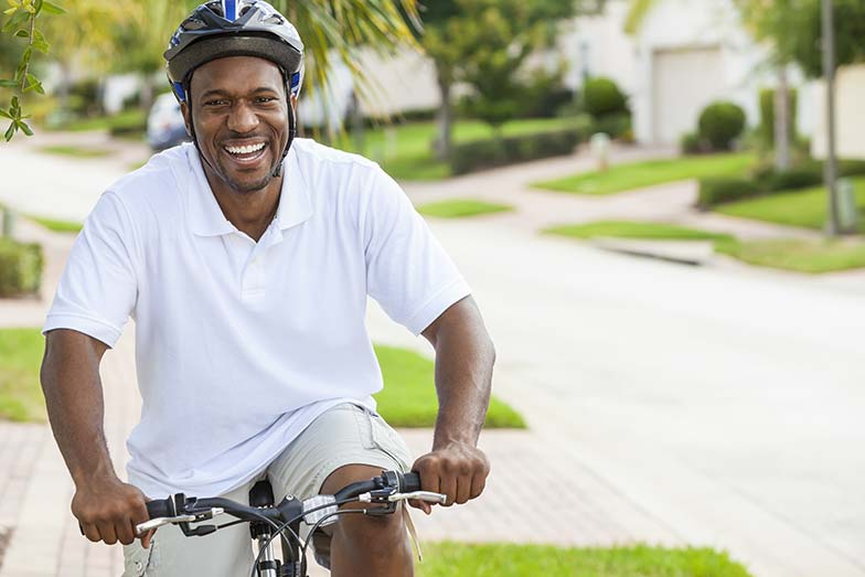 Man riding his bike and smiling