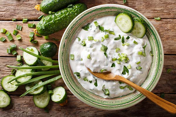 Raita made of curd with cucumber, herbs and spices