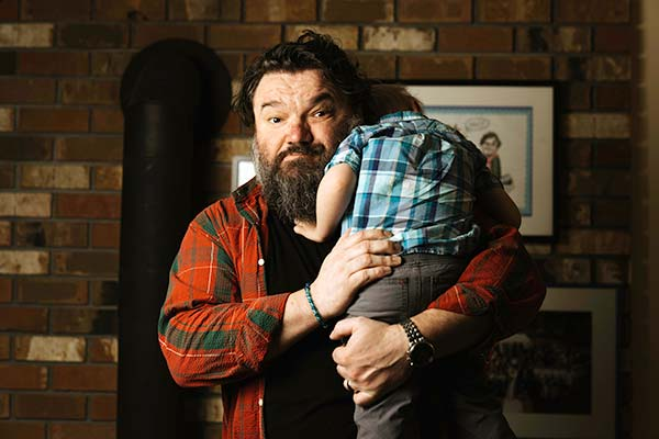 Toby Hargrave carrying his child a micro workout