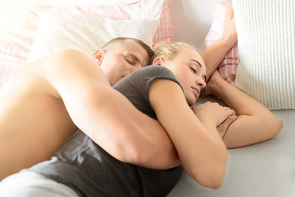 Spooning sex position to relieve back pain