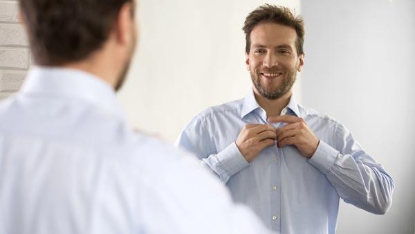 Man smiling in mirror