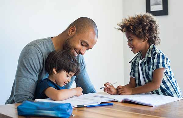 Dad helping kids with homework