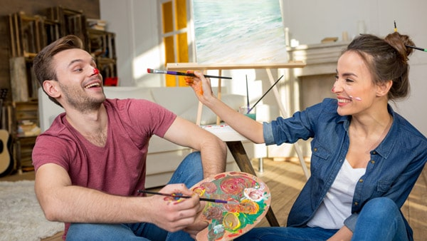 Happy couple painting